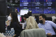 Currency traders watch monitors at the foreign exchange dealing room of the KEB Hana Bank headquarters in Seoul, South Korea, Friday, April 23, 2021. Asian stock markets were mixed Friday after Wall Street fell following a report that President Joe Biden will propose raising taxes on wealthy investors. (AP Photo/Ahn Young-joon)