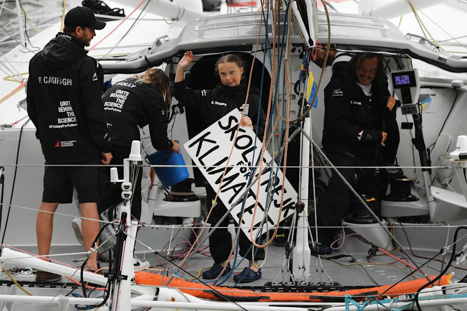 """NEW YORK, NEW YORK - AUGUST 28: Teenage climate activist Greta Thunberg holding a sign that says """"school Strike for Climate"""" in swedish arrives into New York City after crossing the Atlantic in a sailboat on on August 28, 2019 in New York City. The 16-year-old Swedish activist began her journey from Plymouth, England, on Aug. 14 and sailed to New York to speak at the UN Climate Action Summit on September 23. Thunberg, who has started a global series of youth protests around climate change, traveled by sail boat as she wanted a zero-carbon emissions vessel. (Photo by Spencer Platt/Getty Images)"""