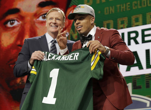 Commissioner Roger Goodell, left, presents Louisville's Jaire Alexander with his Green Bay Packers jersey during the first round of the NFL football draft, Thursday, April 26, 2018, in Arlington, Texas. (AP Photo/David J. Phillip)
