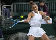 Maria Sakkari of Greece plays a return to Netherland's Arantxa Rus during the women's singles first round match on day two of the Wimbledon Tennis Championships in London, Tuesday June 29, 2021. (AP Photo/Alberto Pezzali)