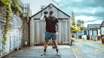 """<p><strong>You'll need: 2 x Dumbbells, floor space</strong><br></p><p>The full workout, as prescribed, is 12 rounds of dumbbell hang squat cleans and handstand push-ups on the dumbbells. As can be expected of all CrossFit Hero workouts, it is hard. But we've adapted it to make it a bit more digestible. We're keeping the hang squat cleans, which will introduce a new movement to most people. But you'll be relieved to know that we will be swapping out the handstand push-ups for normal push-ups performed on the dumbbells.</p><p>""""The dumbbell hang squat clean sound complicated. It's hard to say, even,"""" says <a href=""""https://www.instagram.com/scottbrits/"""" rel=""""nofollow noopener"""" target=""""_blank"""" data-ylk=""""slk:Scott Britton"""" class=""""link rapid-noclick-resp"""">Scott Britton</a>, our resident CrossFit boffin. """"But in reality, it's just bringing the dumbbells to your shoulders and then squatting. Think of them that way and it's a lot easier to get to grips with.""""</p><p><strong>Complete 12 rounds of the following for time:</strong></p><p><strong>Dumbbell Hang Squat Cleans x 10</strong></p><p>Holding a pair of dumbbells at your sides, hinge at the hips to lower them to your knees (A). Now pull the weights up as your being to drop into a squat, using the momentum to catch the dumbbells on to your shoulders (B). Stand up straight, then lower the dumbbells under control to your sides and repeat.</p><p><strong>Push-Ups On The Dumbbells x 6</strong><br><br>Assume a strong plank with your hands on the dumbbells. Your wrists, elbows and shoulders should be directly above one another: think about creating a rigid frame from ankles to head (A). Flex at the elbow, lowering your body, and pause as your chest touches the floor (B). Push up explosively.</p>"""