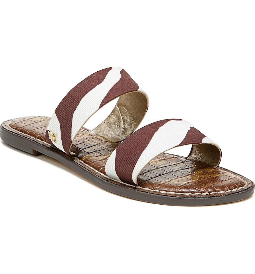 "<p>These printed <a href=""https://www.popsugar.com/buy/Sam-Edelman-Gala-Two-Strap-Slide-Sandals-556915?p_name=Sam%20Edelman%20Gala%20Two%20Strap%20Slide%20Sandals&retailer=shop.nordstrom.com&pid=556915&price=60&evar1=fab%3Aus&evar9=46054622&evar98=https%3A%2F%2Fwww.popsugar.com%2Ffashion%2Fphoto-gallery%2F46054622%2Fimage%2F47309499%2FSam-Edelman-Gala-Two-Strap-Slide-Sandal&list1=shopping%2Csandals%2Cshoes%2Caccessories%2Cspring%2Cspring%20fashion%2Cwide%20feet&prop13=api&pdata=1"" rel=""nofollow"" data-shoppable-link=""1"" target=""_blank"" class=""ga-track"" data-ga-category=""Related"" data-ga-label=""https://shop.nordstrom.com/s/sam-edelman-gala-two-strap-slide-sandal-women/4824394/full?origin=category-personalizedsort&amp;breadcrumb=Home%2FWomen%2FShoes%2FSandals&amp;fashionwidth=8%3A2e~~7%7C8%3Ae~~6%7C8%3Ac~~5&amp;color=pewter%2F%20soft%20silver%20leather"" data-ga-action=""In-Line Links"">Sam Edelman Gala Two Strap Slide Sandals</a> ($60) will look good with so many Summer looks.</p>"