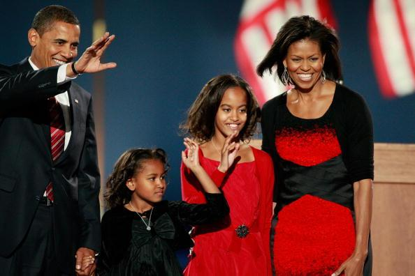 U.S. President elect Barack Obama walks on stage, with his wife Michelle (R) and daughters Malia (2nd R) and Sasha to, address his supports during an election night gathering in Grant Park on November 4, 2008 in Chicago, Illinois. Obama defeated Republican nominee Sen. John McCain (R-AZ) by a wide margin in the election to become the first African-American U.S. President elect. (Photo by Scott Olson/Getty Images)