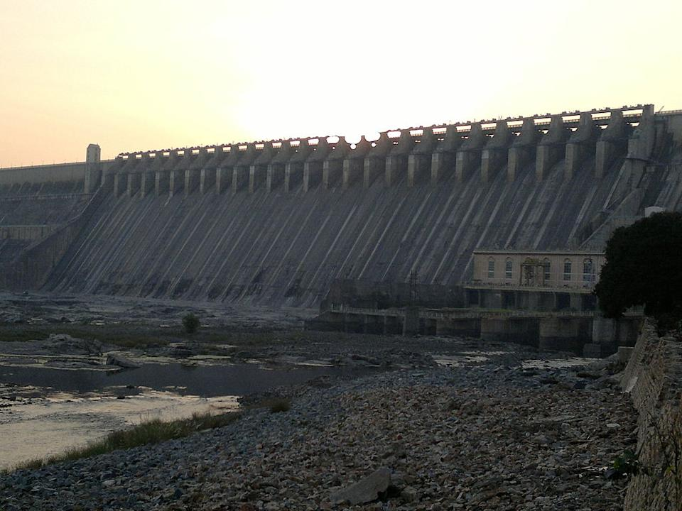Nagarjuna Sagar Dam is the world's largest masonry dam built across Krishna River in Nagarjuna Sagar, Nalgonda District of Andhra Pradesh, India, between 1955 and 1967. The dam contains the Nagarjuna Sagar reservoir with a capacity of up to 11,472 million cubic metres. The dam is 490 ft (150 m). tall and 1.6 km long with 26 gates which are 42 ft (13 m). wide and 45 ft (14 m). tall. Nagarjuna Sagar was the earliest in the series of large infrastructure projects initiated for the Green Revolution in India; it also is one of the earliest multi-purpose irrigation and hydro-electric projects in India. {Photo by Bapi [GFDL (www.gnu.org/copyleft/fdl.html) or CC-BY-SA-3.0-2.5-2.0-1.0 (www.creativecommons.org/licenses/by-sa/3.0)], via Wikimedia Commons}