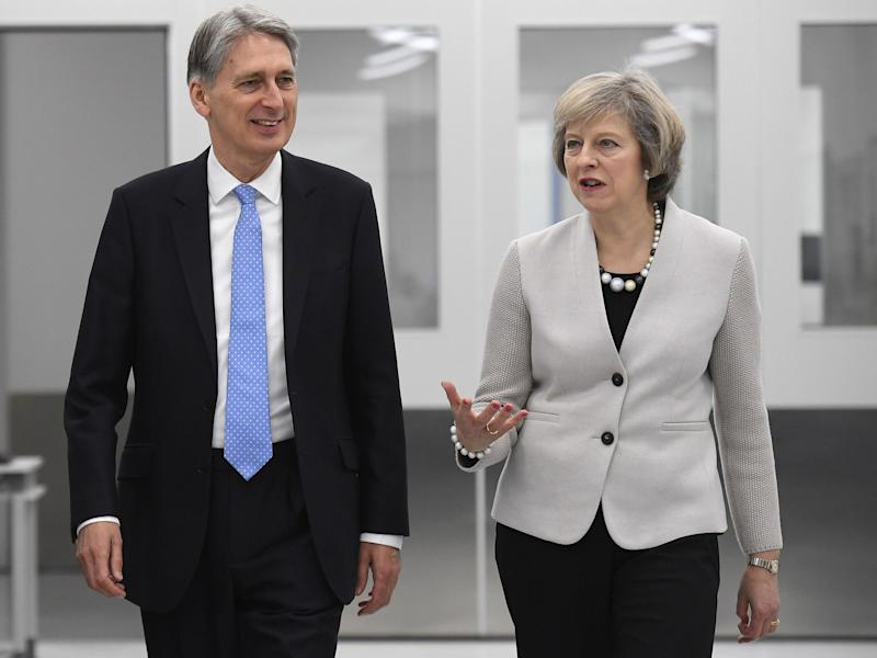 Prime Minister Theresa May and Chancellor Philip Hammond: PA