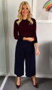 """<p>Holly's Breton style knit has sadly sold out on the Warehouse website due to popular demand but her ruby court <a rel=""""nofollow noopener"""" href=""""https://www.lkbennett.com/product/SCFERNJACQUARDFABRICRedRuby~Fern-Ruby-Closed-Courts-Ruby"""" target=""""_blank"""" data-ylk=""""slk:shoes"""" class=""""link rapid-noclick-resp"""">shoes</a> from L.K Bennett are still up for grabs. </p>"""