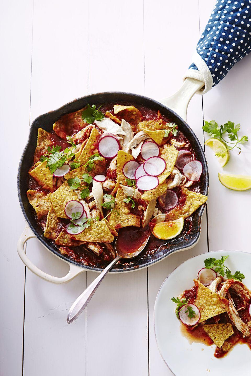 """<p>Crispy tortilla chips covered in tomatoes, green onions, chicken, and radishes ... Is there anything more tempting? </p><p><em><a href=""""https://www.goodhousekeeping.com/food-recipes/easy/a34557/chicken-chilaquiles"""" rel=""""nofollow noopener"""" target=""""_blank"""" data-ylk=""""slk:Get the recipe for Chicken Chilaquiles »"""" class=""""link rapid-noclick-resp"""">Get the recipe for Chicken Chilaquiles »</a></em></p>"""