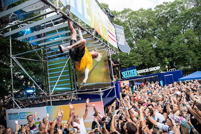 Machine Gun Kelly performs a surprise set on the Bud Light Seltzer Sessions stage on day three of the Lollapalooza Music Festival on Saturday, July 31, 2021, at Grant Park in Chicago. - Credit: Amy Harris/Invision/AP