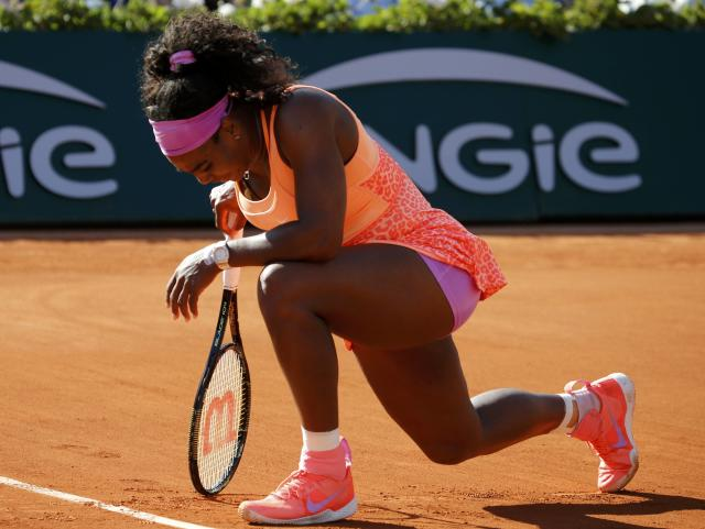 Serena Williams of the U.S. reacst during her women's semi-final match against Timea Bacsinszky of Switzerland at the French Open tennis tournament at the Roland Garros stadium in Paris, France, June 4, 2015. REUTERS/Pascal Rossignol