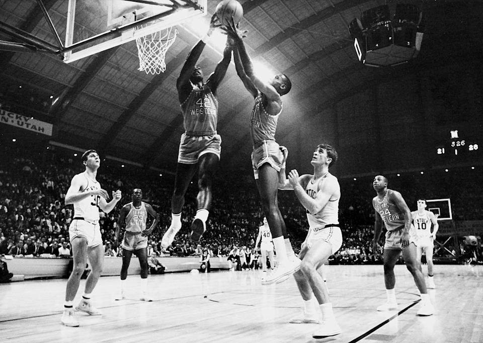 David Lattin (42) and a Texas Western teammate compete for control of a rebound as Kentucky's Tommy Kron, left, and Pat Riley , right, look on during the 1966 NCAA Photos via Getty Images Championship.  Texas Western defeated Kentucky 72-65 for the championship title and was the first team to have an.. all-.black starting five compete in the NCAA Photos via Getty Images final. Rich Clarkson/NCAA Photos via Getty Images