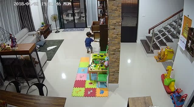 The child can be seen pulling out drawers. Source: ViralHog