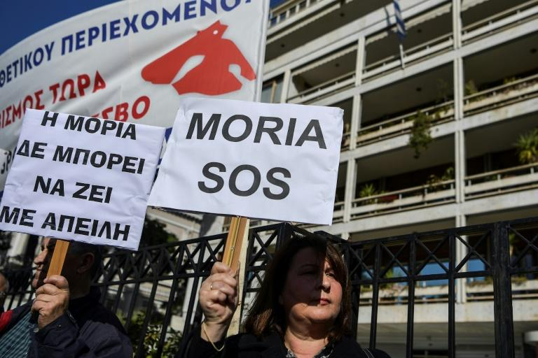 Dozens of demonstrators from the Aegean islands of Lesbos, Chios and Samos gathered outside the interior ministry in Athens on February 13, brandishing banners against the camps project