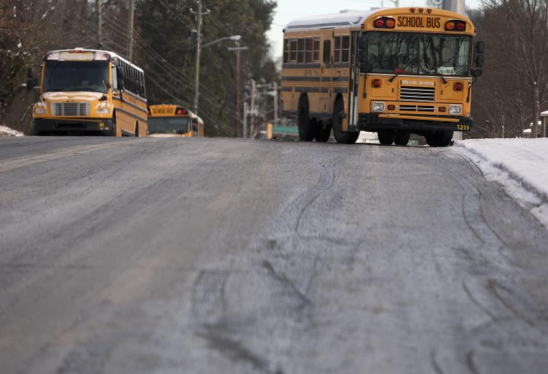 Atlanta public school buses sit abandoned along Metropolitan Parkway in Atlanta