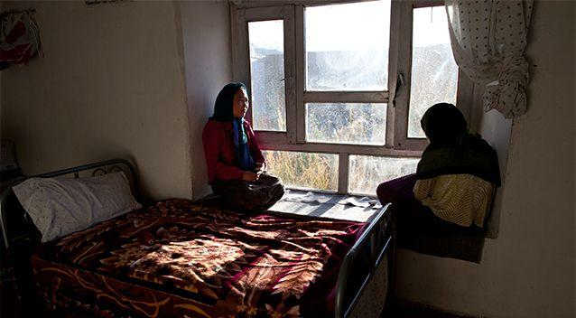Rahima (L), 18, looks out the window of her room with another battered woman at a women's shelter October 8, 2010 in Bamiyan, Afghanistan. Rahima, from Maydan Wardak, was a child bride, forced to marry at age 11. Until women's shelters were started, something that was unknown here before 2003, a woman in an abusive marriage usually had no one to go to for protection. Photo: Getty Images