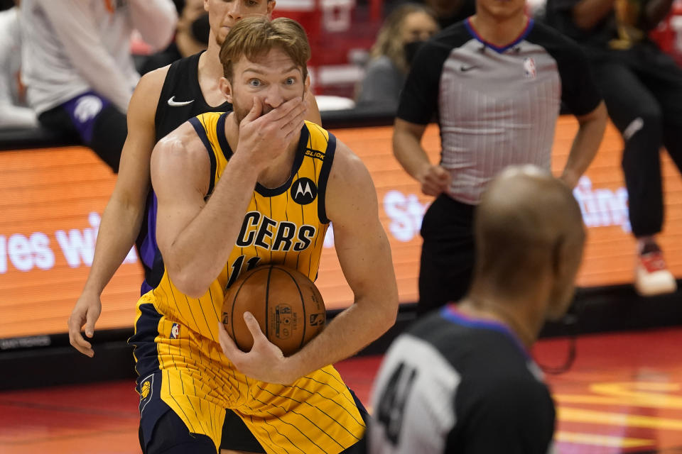 Indiana Pacers forward Domantas Sabonis (11) reacts as he is called for an offensive foul by referee Tom Washington (49) during the second half of an NBA basketball game against the Toronto Raptors Sunday, May 16, 2021, in Tampa, Fla. (AP Photo/Chris O'Meara)