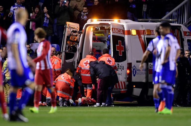 Atletico Madrid's forward Fernando Torres was evacuated in an ambulance after he was knocked unconscious during the Spanish league match against Deportivo La Coruna at the Riazor stadium on March 2, 2017
