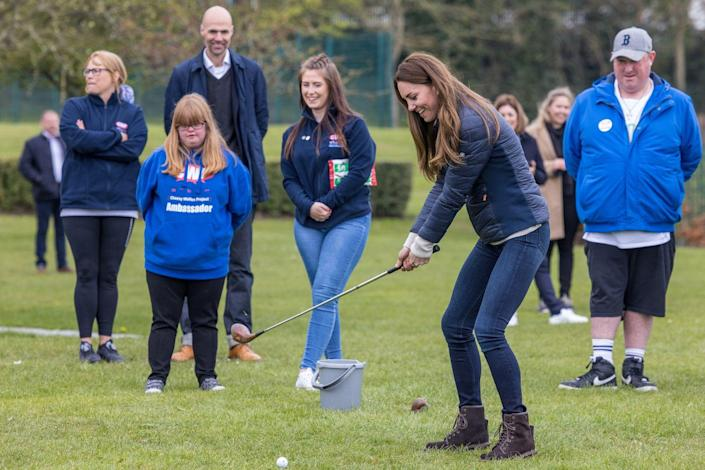 <p>The Duchess of Cambridge tried her hand at golf while visiting young people supported by the Cheesy Waffles Project, a charity for children and adults with special needs. The group played sports at the Belmont Community Center in Durham, UK. <br></p>