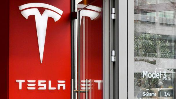 PHOTO: In this Jan. 27, 2020, file photo, the logo of the electric car manufacturer Tesla is shown at a Tesla store in Berlin. (Jens Kalaene/Picture-Alliance/DPA via AP, FILE)