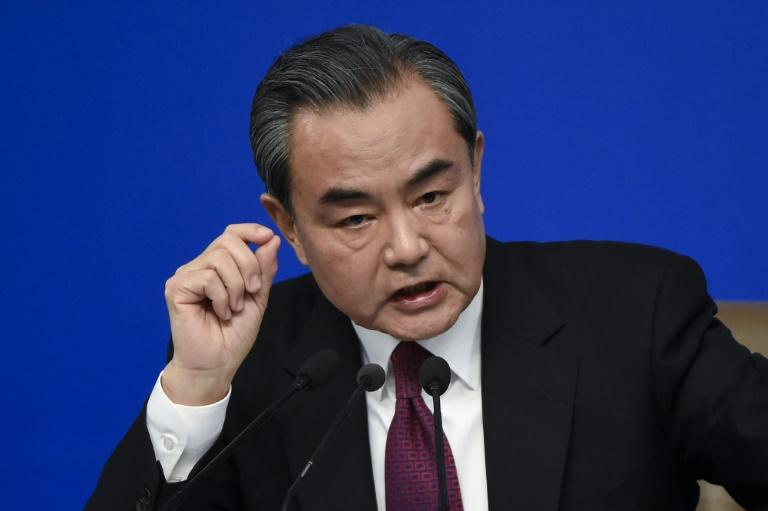 China's Foreign Minister Wang Yi answers a question at a press conference during the Fifith Session of the 12th National People's Congress (NPC) in Beijing on March 8, 2017