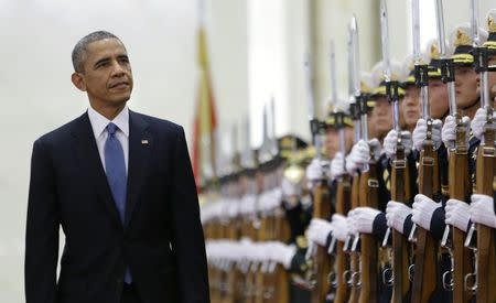 U.S. President Barack Obama inspects the honour guards with China's President Xi Jinping (not pictured) during a welcoming ceremony at the Great Hall of the People in Beijing, November 12, 2014. REUTERS/Jason Lee