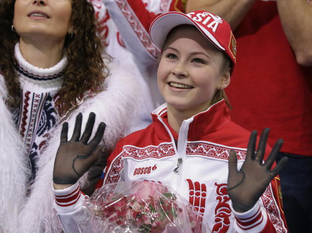 Julia Lipnitskaia of Russia waves to spectators in the results area after competing in the women's team free skate figure skating competition at the Iceberg Skating Palace during the 2014 Winter Olympics, Sunday, Feb. 9, 2014, in Sochi, Russia. (AP Photo/Darron Cummings, Pool)