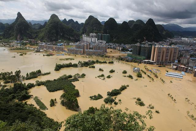 <p>A general view shows a flooded area in Liuzhou, Guangxi province, China, July 2, 2017. (Photo: Stringer/Reuters) </p>