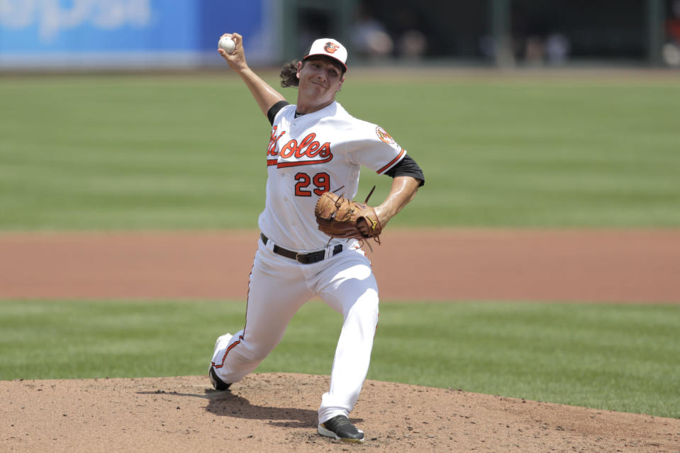 Baltimore Orioles starting pitcher Asher Wojciechowski pitches to a Boston Red Sox batter during the second inning of a baseball game, Sunday, July 21, 2019, in Baltimore. (AP Photo/Julio Cortez)
