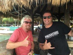 The BitClub Network's Jobadiah Weeks pictured with Sir Richard Branson in 2016