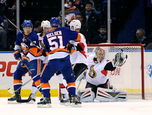 Ottawa Senators goalie Craig Anderson (41) blocks a shot by the New York Islanders during the first period of an NHL hockey game Tuesday, April 8, 2014, in Uniondale, N.Y. (AP Photo/Kathy Kmonicek)