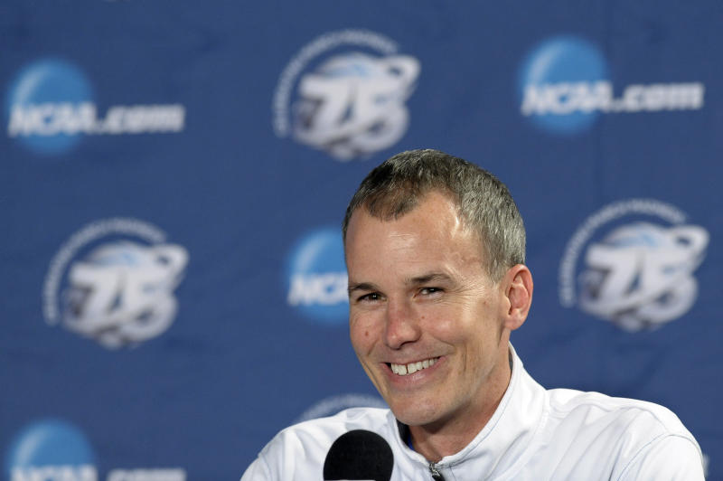 Florida Gulf Coast head coach Andy Enfield smiles during a news conference for a third-round game of the NCAA college basketball tournament, Saturday, March 23, 2013, in Philadelphia. Florida Gulf Coast is scheduled to play San Diego State on Sunday. (AP Photo/Michael Perez)