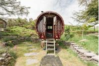 """<p>Book a staycation with a difference with this traditional gypsy caravan, located on a remote mountain top in Wales. The owners have painstakingly restored the original 1920s frame to create a whimsical accommodation option, full of hand-carved and painted details, gold leaf, brocade and brass. That's not to say that the caravan doesn't offer modern luxuries - WiFi, a coffee machine and an indoor fireplace are all part of the package. The peaceful views across the valleys will prove restorative, while the secluded sauna will help you to relax in earnest. </p><p>Machynlleth, Wales. To book, visit <a href=""""https://go.redirectingat.com?id=127X1599956&url=https%3A%2F%2Fwww.airbnb.co.uk%2Frooms%2Fplus%2F12252718%2Famenities%3Ffederated_search_id%3D3c880d55-90c7-4e3d-a3a7-2e917b37bbfb%26source_impression_id%3Dp3_1614698509_Z9kxQH44zWZ81a5q%26guests%3D1%26adults%3D1&sref=https%3A%2F%2Fwww.harpersbazaar.com%2Fuk%2Ftravel%2Ftravel-guides%2Fnews%2Fg36818%2Fthe-best-glamping-in-the-uk%2F"""" rel=""""nofollow noopener"""" target=""""_blank"""" data-ylk=""""slk:airbnb.co.uk"""" class=""""link rapid-noclick-resp"""">airbnb.co.uk</a>.</p>"""
