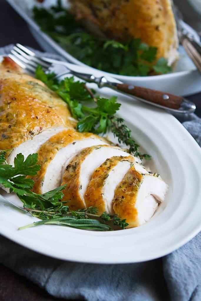 """<p>This herb-roasted turkey breast is only 190 calories a serving and takes just a few minutes to prepare for roasting. You can serve it with a small side salad or pair it with hearty mashed potatoes. The choice is yours!</p> <p><strong>Get the recipe:</strong> <a href=""""http://www.cookincanuck.com/herb-roasted-turkey-breast-recipe/"""" class=""""link rapid-noclick-resp"""" rel=""""nofollow noopener"""" target=""""_blank"""" data-ylk=""""slk:herb-roasted turkey breast"""">herb-roasted turkey breast</a></p>"""