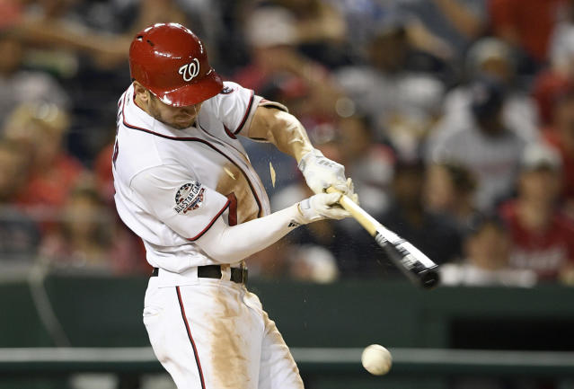 Washington Nationals' Trea Turner splinters his bat as he ground out during the third inning of a baseball game against the Philadelphia Phillies, Sunday, June 24, 2018, in Washington. (AP Photo/Nick Wass)