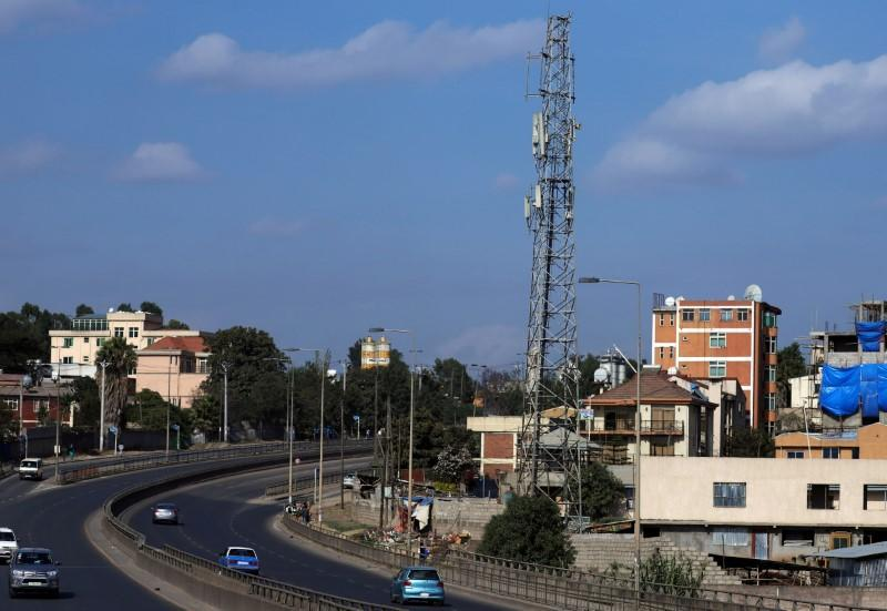 FILE PHOTO: Motorists drive past an Ethio-Telecom network tower in Addis Ababa