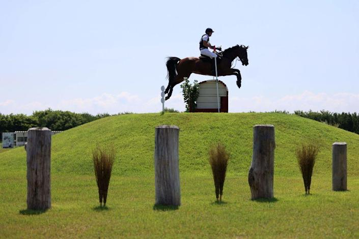<p>Czech Republic's Miroslav Trunda riding his horse, Shutterflyke, in the equestrian eventing team and individual cross country competition.</p>