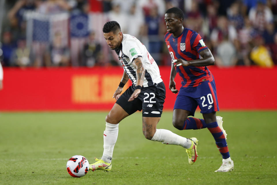 Costa Rica's Ronald Matarrita, left, controls the ball as United States' Tim Weah defends during the second half of a World Cup qualifying soccer match Wednesday, Oct. 13, 2021, in Columbus, Ohio. The United States won 2-1. (AP Photo/Jay LaPrete)