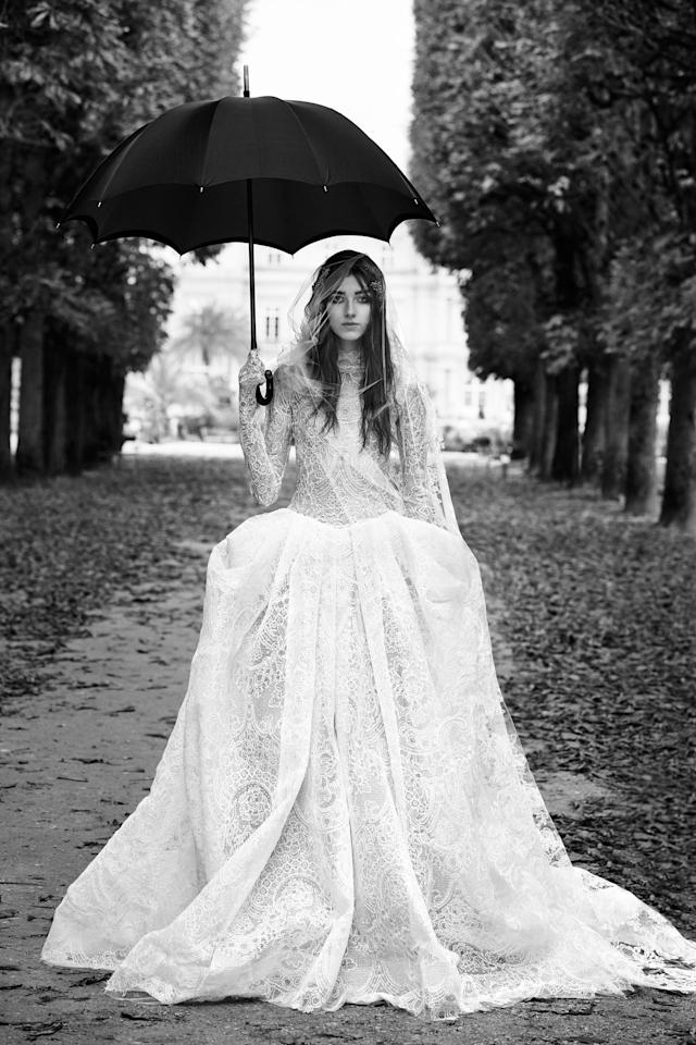 <p><i>Long-sleeve ball gown with macramé lace panels. (Photo: Courtesy of Vera Wang/Patrick Demarchelier) </i></p>