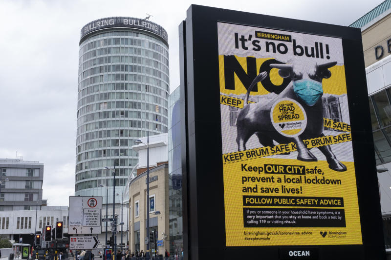 As numbers of Covid-19 cases in Birmingham have increased in recent weeks, and with the city added as an 'area of enhanced support' on the UK's coronavirus watchlist of critical areas which are under threat of a local lockdown, people interact beneath a new public health advice advertising campaign featuring Bully the Bull Ring bull wearing a face mask with the slogan 'It's NO bull. Keep Brum safe' near to the iconic Rotunda building in the city centre on 24th August 2020 in London, United Kingdom. With other areas in the Midlands under localised lockdown, people and businesses are being urged to follow the Coronavirus advice for workplace and family life help reduce the risk. (photo by Mike Kemp/In PIctures via Getty Images)