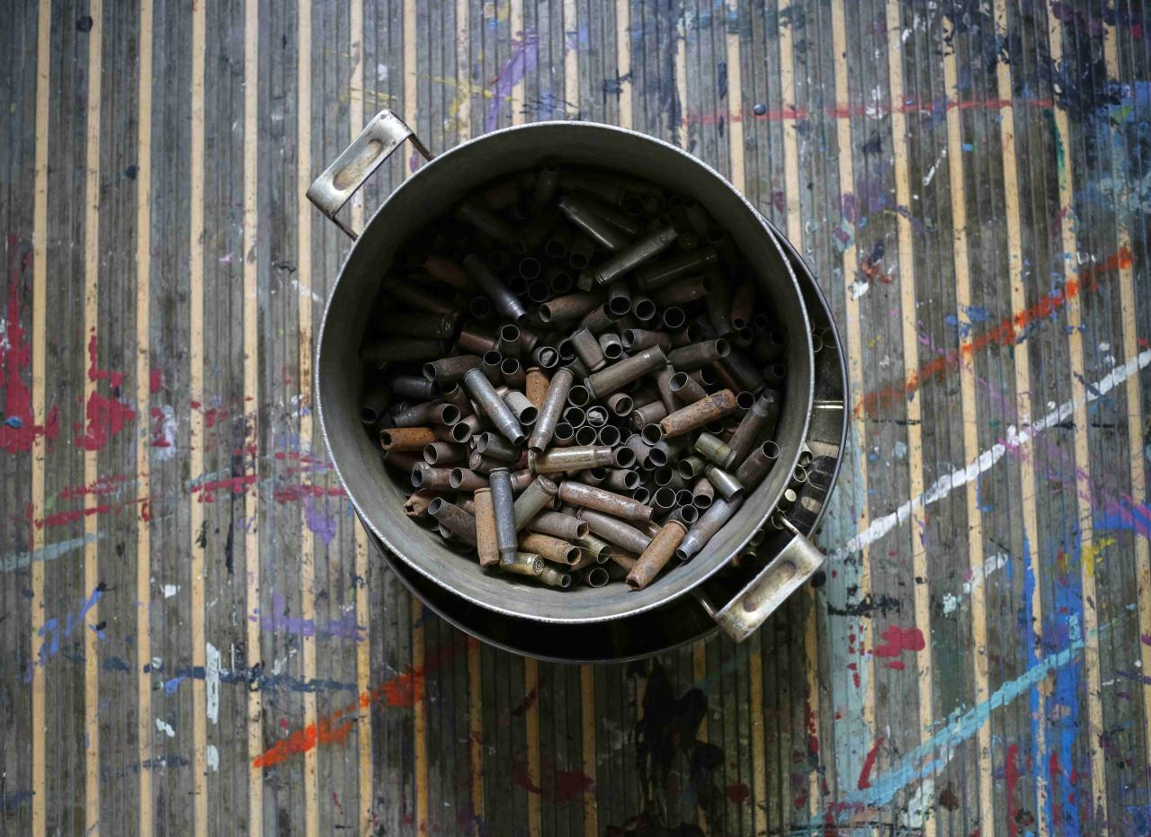 A pan with cartridges brought from the frontline in eastern Ukraine, is seen in a studio of Ukrainian artist Dariya Marchenko, in Kiev, July 22, 2015. Daria Marchenko calls her art approach philosophic symbolism where every element has its hidden meaning. In her works cartridges mean human's life that was brutally ended. Picture taken July 22, 2015. REUTERS/Gleb Garanich