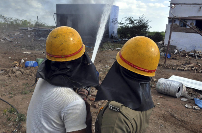 Firemen spray water after a massive blaze swept through the Om Siva Shakti fireworks factory in Sivakasi, about 650 kilometers (400 miles) southwest of Chennai, India, Wednesday, Sept.5, 2012. Large amounts of firecrackers and raw materials were stored in the factory with major Hindu festivals weeks away. Dozens of workers were killed and dozens were injured in the fire, the cause of which was not immediately known.(AP Photo)