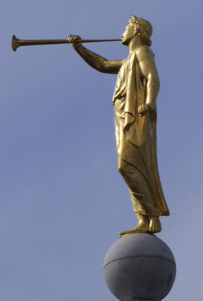 FILE - In this Sept. 4, 2018, file photo, the angel Moroni statue sits atop the Salt Lake Temple, at Temple Square in Salt Lake City. The Church of Jesus Christ of Latter-day Saints on Tuesday, Dec. 17, 2019, defended how it uses and invests member donations after a former church employee charged in a complaint to the Internal Revenue Service that the faith had improperly built a $100 billion investment portfolio using member donations that are supposed to go to charitable causes. (AP Photo/Rick Bowmer, File)