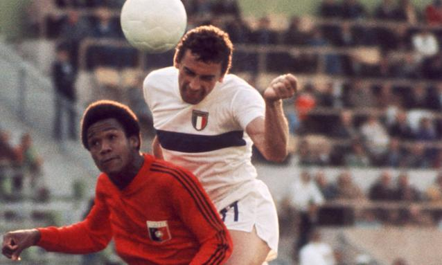 Luigi Riva, right, jumps over Arsène Auguste during Italy's group game match against Haiti in the 1974 World Cup.