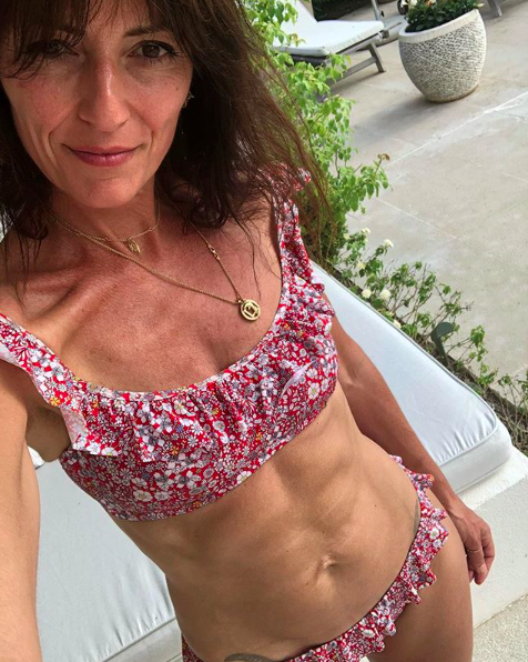 <p>The 50-year-old TV presenter gave us all #fitnessgoals this week when she posed in this cute, J Crew two piece. [Photo: Instagram/davinamccall] </p>
