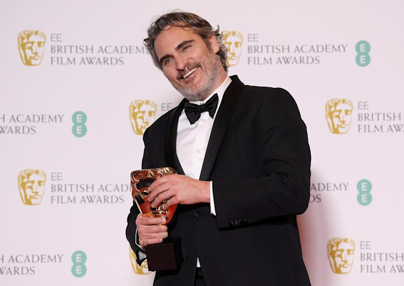 Joaquin Phoenix poses with his award for Leading Actor for 'Joker' at the British Academy of Film and Television Awards (BAFTA) at the Royal Albert Hall in London, Britain, February 2, 2020. REUTERS/Toby Melville TPX IMAGES OF THE DAY
