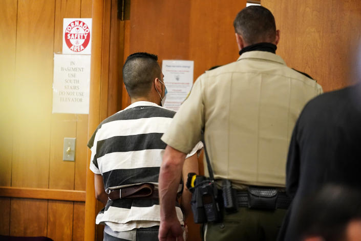 Cristhian Bahena Rivera, left, is escorted out of the courtroom after his sentencing, Monday, Aug. 30, 2021, at the Poweshiek County Courthouse in Montezuma, Iowa. Rivera was sentenced to life in prison for the stabbing death of college student Mollie Tibbetts, who was abducted as she was out for a run near her small eastern Iowa hometown in July of 2018. (AP Photo/Charlie Neibergall, pool)