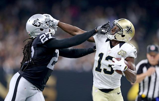 <p>Oakland Raiders defensive back Reggie Nelson (27) pushes New Orleans Saints wide receiver Michael Thomas (13) out of bounds after a catch in the second quarter at the Mercedes-Benz Superdome. Mandatory Credit: Chuck Cook-USA TODAY Sports </p>