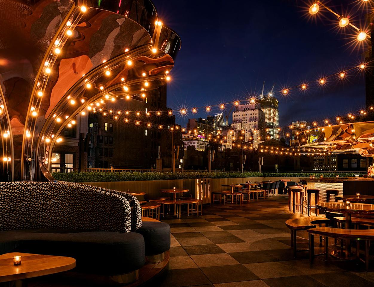 """<p>As much an experience as it is a rooftop bar, the Magic Hour atop the <a href=""""http://moxy-hotels.marriott.com/nyc/timessquare/dining/magic-hour-rooftop-bar-lounge/"""" target=""""_blank"""">Moxy Hotel</a> in Midtown features a variety of spaces, including multiple bars, a moving carousel, and a slightly racy putt-putt course. The cocktails and boozy treats are equally whimsical with playful options like the Margarita Gummy Bear and alcoholic push-pops. </p>"""