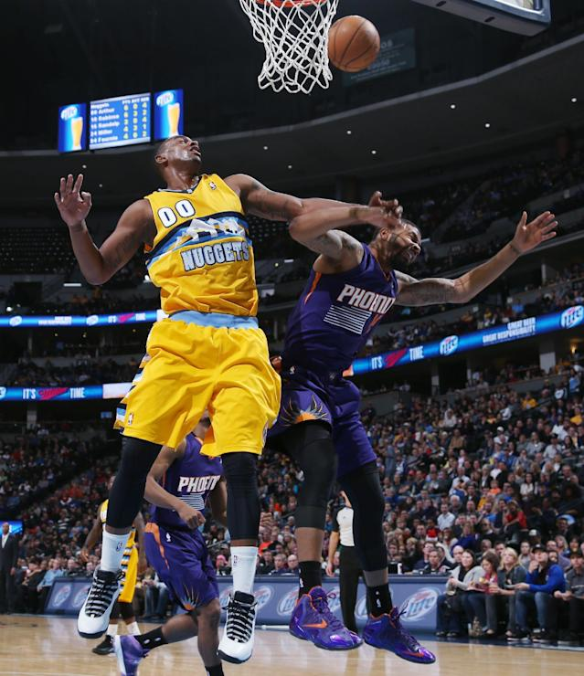 Denver Nuggets forward Darrell Arthur, left, battles for a rebound with Phoenix Suns forward Marcus Morris in the third quarter of the Suns' 103-99 victory in an NBA basketball game in Denver on Friday, Dec. 20, 2013. (AP Photo/David Zalubowski)