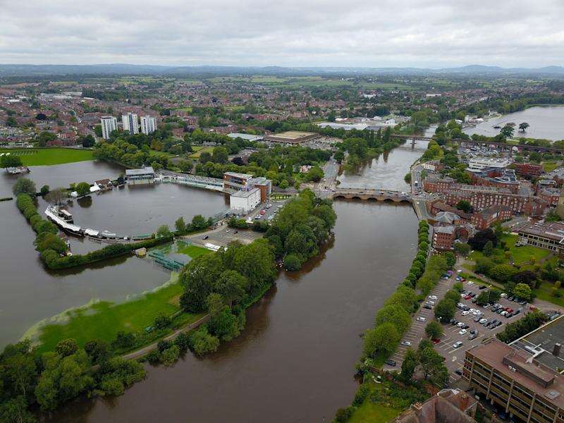 """Worcestershire CCC's, New Road, ground under water due to flooding from the River Severn in Worcester, after heavy rainfall. 17/06/2019. See SWNS story SWMDweather. Britain will be pummelled by """"persistent rain"""" over the next few days with the risk of """"severe thunderstorms"""" developing as the unrelenting summer washout rages on. The increased likelihood of damaging storms has forced the Met Office to issue a yellow weather warning."""