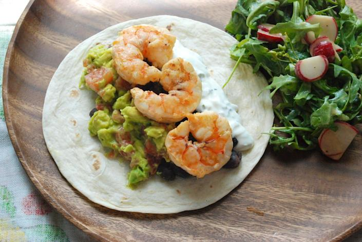 "<strong>Get the <a href=""http://food52.com/recipes/19165-shrimp-tacos"" rel=""nofollow noopener"" target=""_blank"" data-ylk=""slk:shrimp tacos recipe"" class=""link rapid-noclick-resp"">shrimp tacos recipe</a> by Cristina Sciarra via Food52.</strong>"